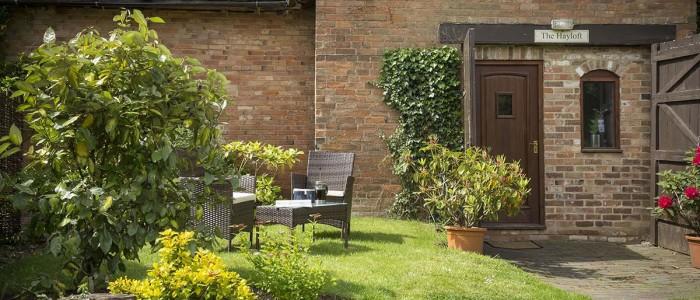 The Hayloft Cottage Garden Area - Prestige Cottages